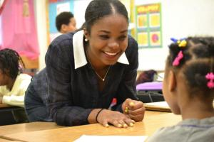 Howard students work with elementary school and high school students in their classrooms.