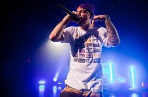 Rapper Mac Miller is performing for an audience