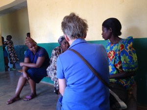 Dr Patricia talks to a patient (far right) who is HIV+