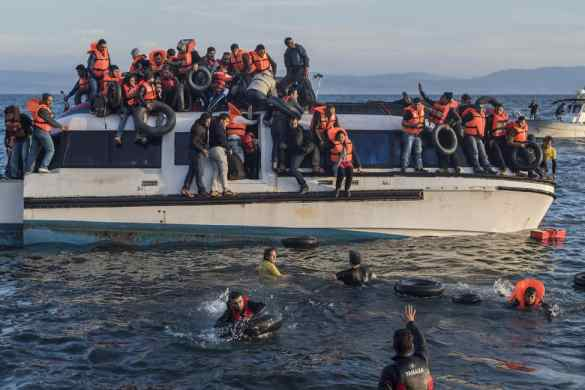 Syrian and Iraqi immigrants getting off a boat from Turkey on the Greek island of Lesbos. Georgios Giannopoulos (Ggia)