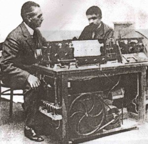 Armand Givelet & Edouard Coupleux at the paper-punch controls of the 'Givelet'