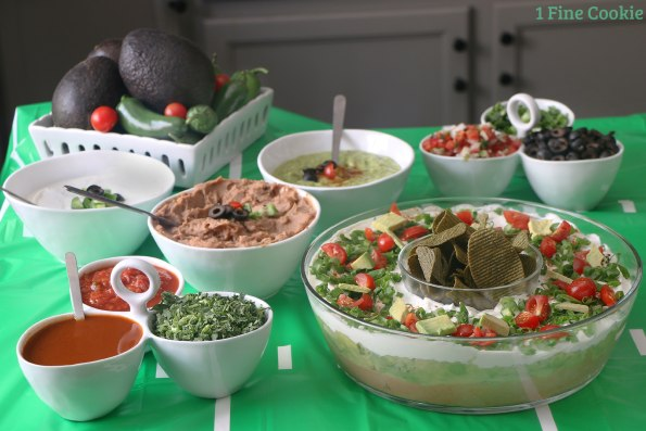 football bites, football, simply 7, tailgating, food, layered, dip, season, ideas, recipe, veggie, chips, hummus, healthy, tex mex, shaped, fresh, clean, table, snacks, appetizers, laces, guacamole, video, lentil, quinoa,