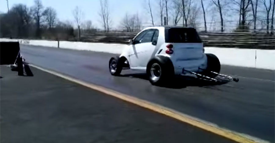 Drag Footage of a Smart Car Powered By a Big Block Chevy Engine