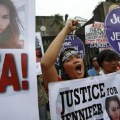 Protesters chant anti U.S. slogans during a rally against the killing of Laude, in Manila