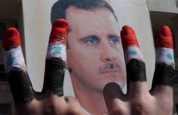 assad-rally-march-2011-fingers