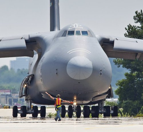 A C-5 Galaxy offloads an 81-foot boat for the US Navy at Coronado - aerospace engineer job description