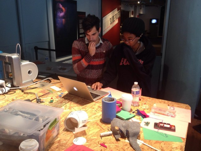 nzingambande:</p><br /><br /> <p>[Photo Courtesy of Andrew Hong. MIT Museum. Left to Right. Andrew Wong, Netia McCray (Me), and Leslie Tita]<br /><br /><br /> As part of my dedication this semester to learning as much as I can about prototyping mechanical and electrical hardware, I signed myself up to participate in the MakewithMOTO Makeathon at the MIT Museum.<br /><br /><br /> We spent two days prototyping a storytelling product that interacts with the Motorola Razr HD Smartphone. As a child plays a story on the Motorola smartphone, the storytelling board will flash its embedded LEDs to correspond to certain moments in the story that need special effects (e.g. when the story comes across the word 'storm' the LEDs will flash quickly in order to stimulate a storm).<br /><br /><br /> I was proud of myself for getting the hang of Solidworks in order to create the hardware shell on the generously provided laser cutter and 3D printer (from 3D Systems) as well as working on the electronic component of the piece with a touch of programming in the Motorola environment Protocoder.<br /><br /><br /> I also had an amazing team this weekend.<br /><br /><br /> Special Thanks to the MakewithMOTO team, Andrew Hong, and last but not least Leslie Tita for coming up with the project idea.<br /><br /><br /> Now, to start on my homework that I have been procrastinating on for the duration of this four-day weekend.<br /><br /><br /> #thegrindisreal<br /><br /><br />