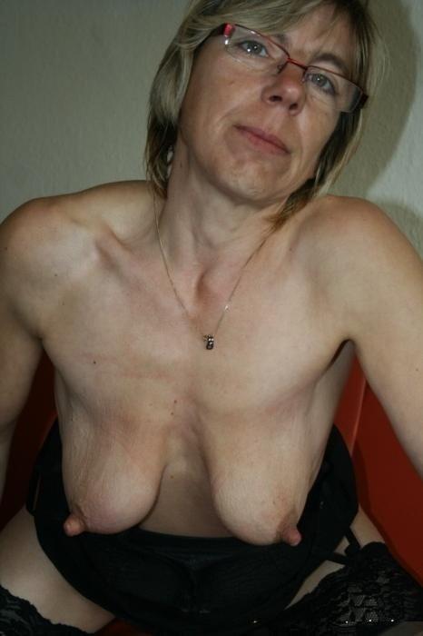 mature saggy tits bent over