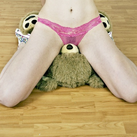 girl grinding stuffed toys