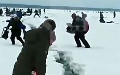 凍った湖で釣り中に突然氷が割れ始めるパニック映像
