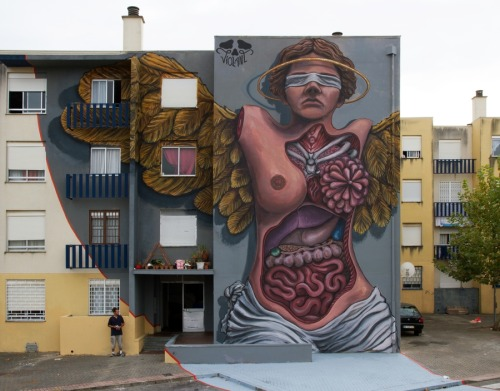 streetartglobal:  A mural of epic scale from @violant3 in Portugal. http://globalstreetart.com/violant