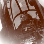 Dave Diehl, radar operator, sitting in Black Widow.  Circa 1945