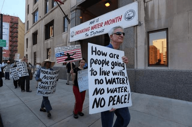 Protesters fight water privatization in Detroit. Photo courtesy Institute for Public Accuracy