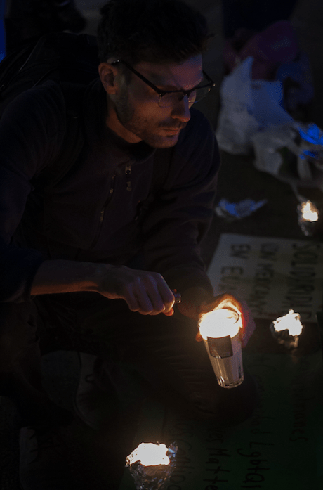 Protestors light candles to be placed on the steps of the Angel de Independencía. Photo by Sandra Blow