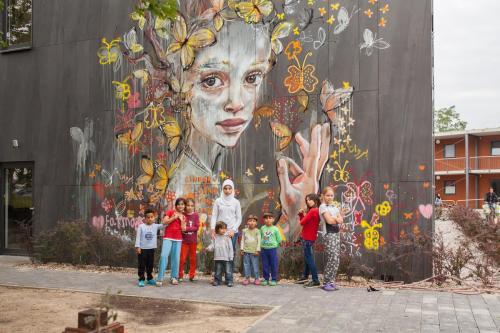 widewalls-artmagazine:   Superb piece by HERAKUT for Street Art workshop in Refugee Asylum in Potsdam, Germanyhttp://www.widewalls.ch/artist/herakut/