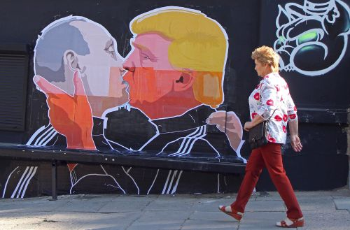 huffpostqueervoices:Donald Trump And Vladimir Putin Will Not Like This Street Art Mural…but we love artist Mindaugas Bonanu's latest piece! (Photos by Getty)