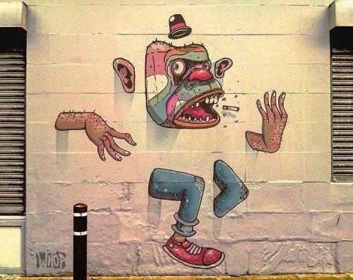 bizarrebeyondbelief:  New work by @whoa_ on the streets of Amsterdam. #whoa #streetart #mural