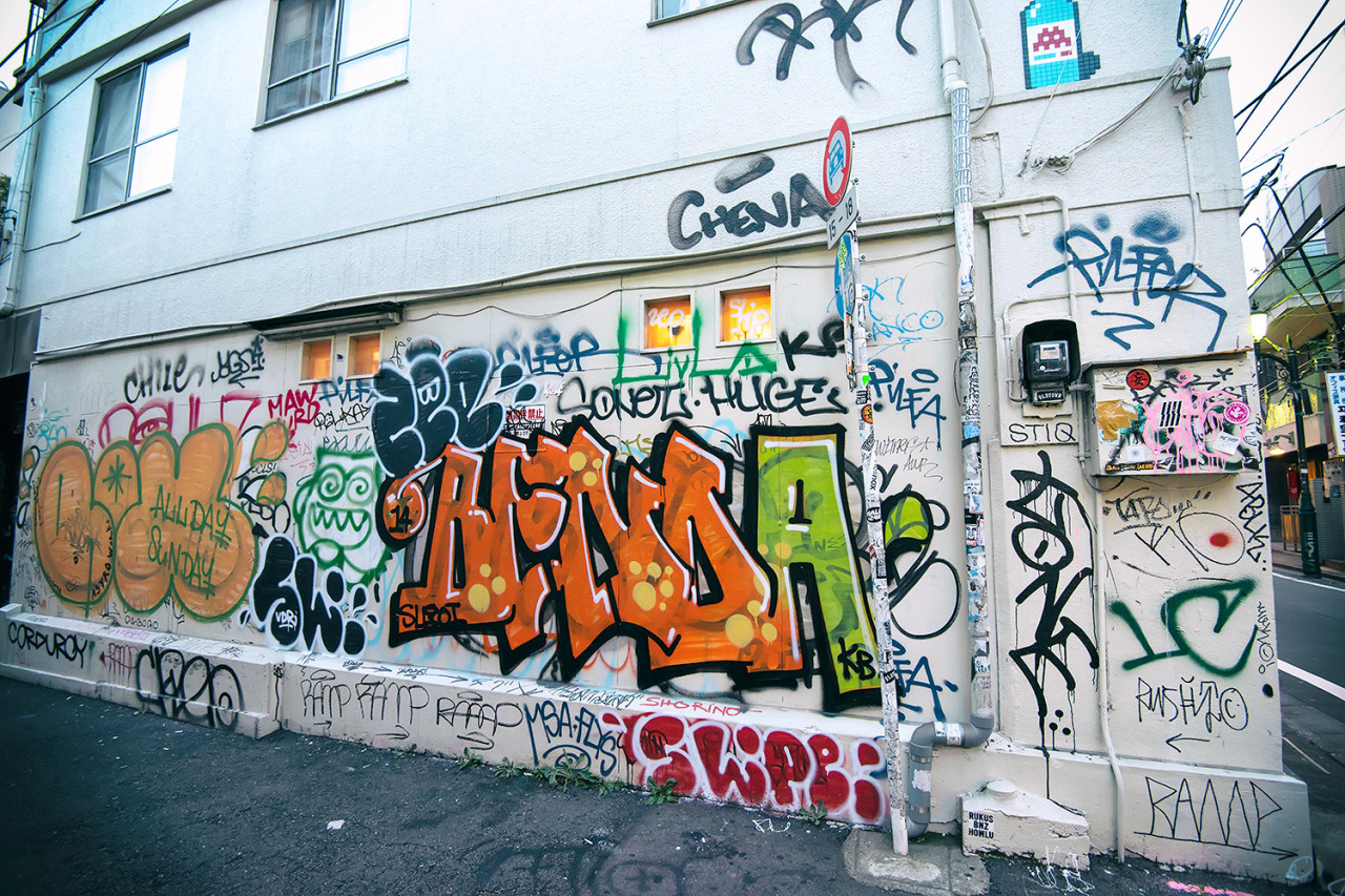 The graffiti wall on the side of the famous nadia harajuku boutique so many tourists