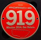 grill-badge-porsche-919-mission-2014-our-return-