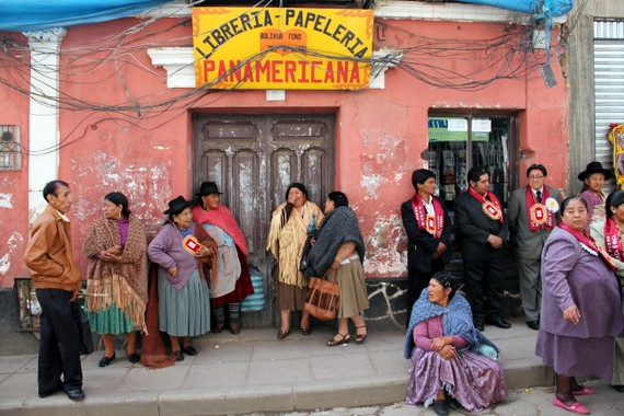 Women with bowler hats wrapped in tassled shawls in Potosi Bolivia