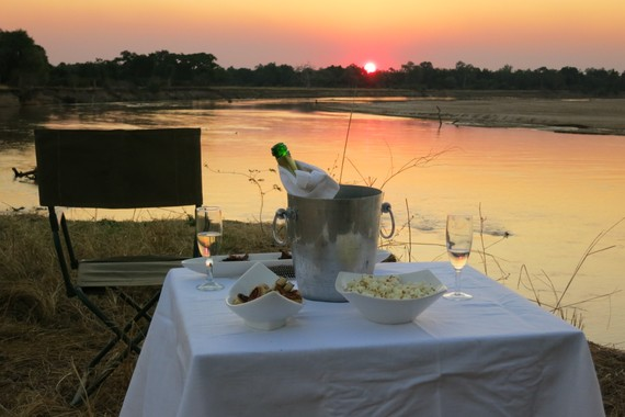 Sundowners and hors d' oeuvres to toast our honeymoon, Nsefu Camp, Zambia