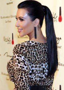 Kim Kardashian wears a middle ponytail for this seasons ponytails trend. *Photo Credit: Poshpearls