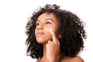 woman-applying-moisturizermadamenoire