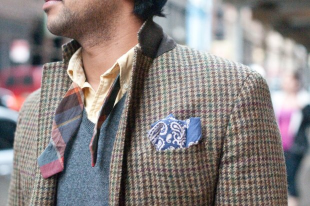 Tweed jacket, pocket square and loose bow tie