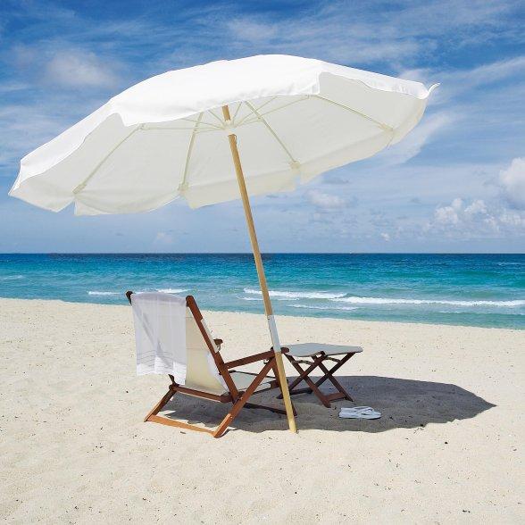 A beach umbrella in the sand