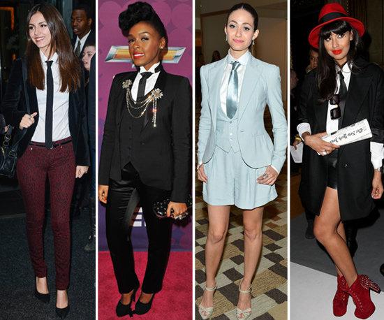 Four females each wearing a necktie
