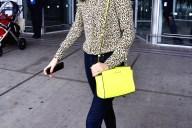 Miranda Kerr Wears A Neon Yellow Purse