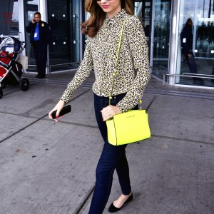 Miranda Kerr Wears A Neon Yellow Purse