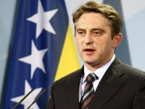 Chairman of Bosnia's tripartite presidency Komsic addresses a news conference in Berlin