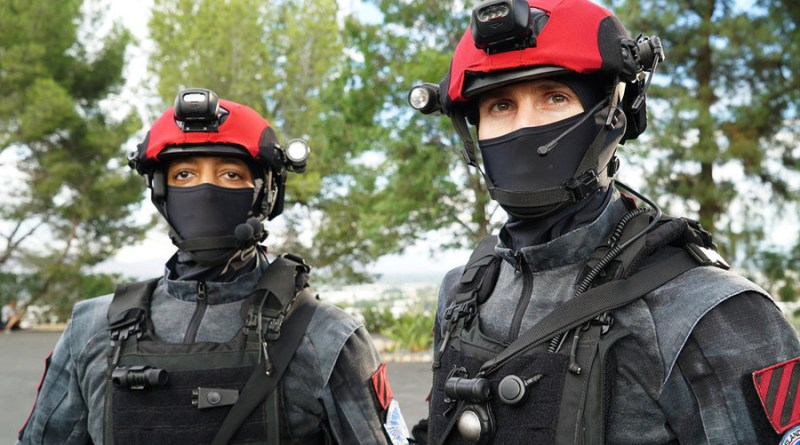 "COLONY -- ""Blindspot"" Episode 104 -- Pictured: The Red Hats -- (Photo by: Danny Feld/USA Network)"