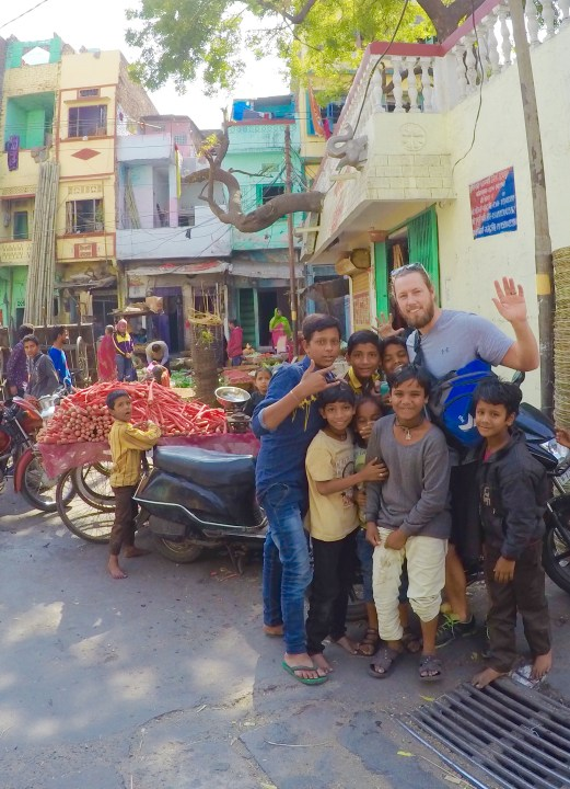 After roaming the spice and vegetable markets of Pushkar, a holy city in the northern state of Rajasthan, I was thrilled to take a picture with these local kids who are never short on smiles. (Photo Adam Meeker)
