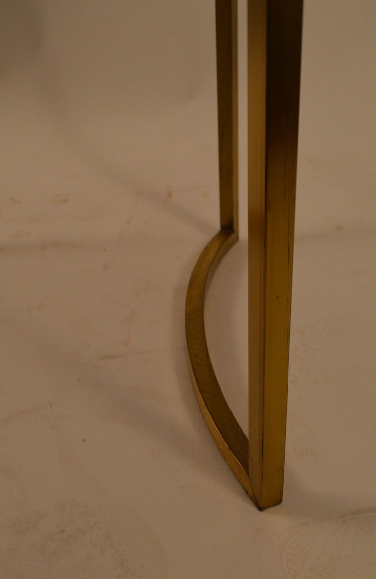 pair of x base brass side tables
