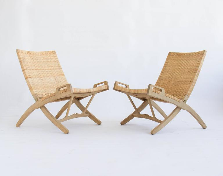 Pair Of Hans Wegner Oak And Cane Folding Lounge Chairs For