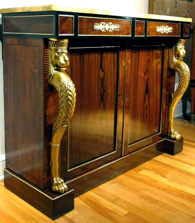 A Regency Rosewood and Parcel-Gilt Side Cabinet in the Manner of - rosewood case