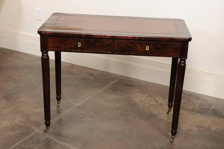 English Mahogany Desk On Casters With Brown Leather Top