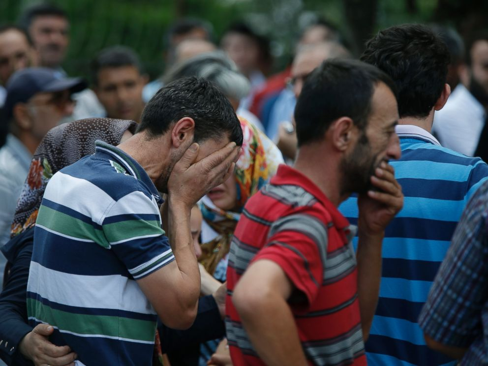 PHOTO: Family members of victims cry outside the Forensic Medical Center in Istanbul, June 29, 2016.