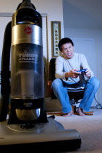 Man Plays Video Games Instead of Vacuuming