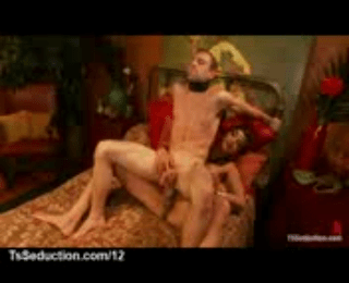Busty Tranny Gets Guy On Top Of Dick On Bed