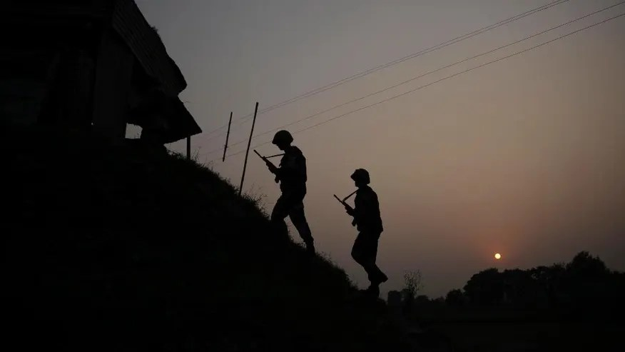 Indian Border Security Force soldiers patrol near the India-Pakistan international border area at Gakhrial boder post in Akhnoor sector, about 48 kilometers from Jammu, India, Saturday, Oct. 1, 2016. India asserted Thursday it carried out