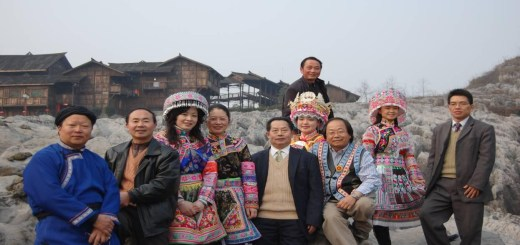 """Dr. Kou Yang's 2008 visit to the Stone Forest Geological Park (Behind is the """"House of Hmong King"""")"""