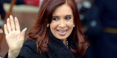 Argentina's President Cristina Fernandez waves to photographers as she arrives for the Mercosur trade bloc summit in Montevideo, Uruguay, Friday, July 12, 2013. Paraguay is expected to be readmitted into the bloc after member nations suspended its membership last year for having impeached and ousted President Fernando Lugo. (AP Photo/Matilde Campodonico)