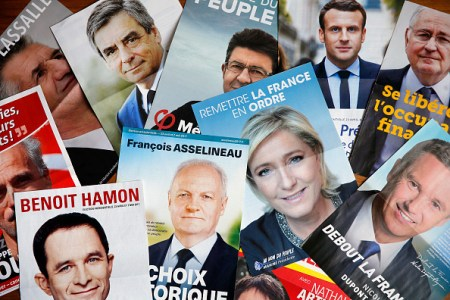 PARIS, FRANCE - APRIL 20:  In this photo illustration, posters with the electoral program of the eleven candidates in the French presidential election are seen on April 20, 2017 in Paris, France. French 2017 presidential election which will take place on April 23 and May 07, 2017.  (Photo Illustration by Chesnot/Getty Images)
