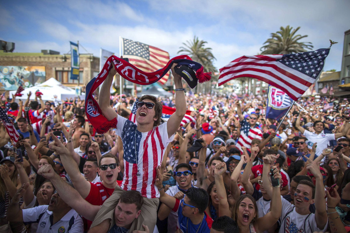Fans cheer after the U.S. scored a second goal during the 2014 Brazil World Cup Group G soccer match between Ghana and the U.S. at a viewing party in Hermosa Beach