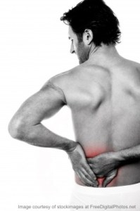 Young Man Holding His Lower Back In Pain w credit