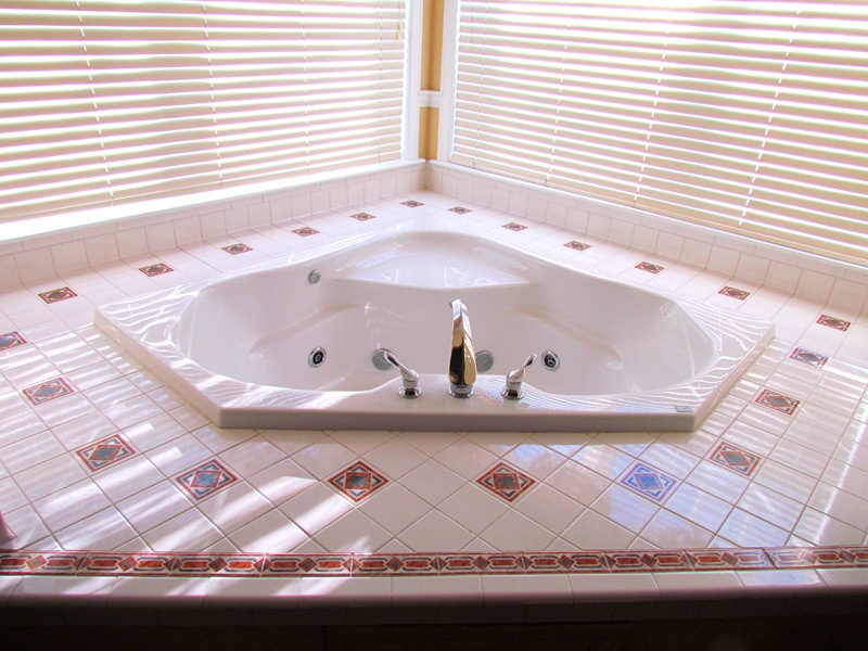 The Jacuzzi tub in the Manor master bedroom. - Acadia Village Resort