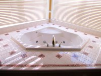 The Jacuzzi tub in the Manor master bedroom.